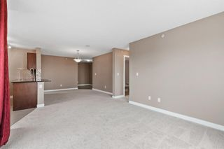 Photo 5: 7411 403 Mackenzie Way SW: Airdrie Apartment for sale : MLS®# A1152134