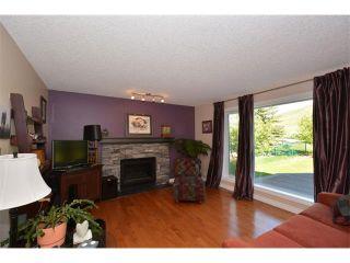 Photo 16: 148 GLENEAGLES Close: Cochrane House for sale : MLS®# C4010996