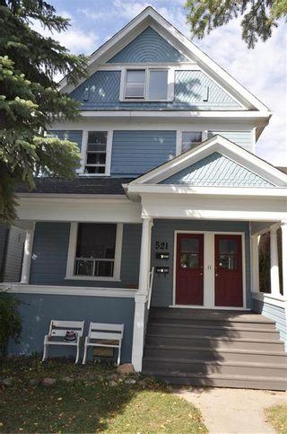 Photo 1: 521 Gertrude Avenue in Winnipeg: Residential for sale (1B)  : MLS®# 202123589