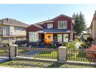 Photo 1: 3836 RUMBLE STREET - LISTED BY SUTTON CENTRE REALTY in Burnaby: Suncrest House for sale (Burnaby South)  : MLS®# R2002202