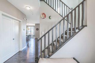 Photo 2: 203 Boulder Creek Bay SE: Langdon Detached for sale : MLS®# A1149788