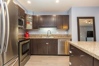 Photo 1: 313 5438 198TH Street in Langley: Langley City Condo for sale : MLS®# R2512995