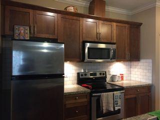 Photo 9: 405 8168 120A Street in Surrey: Queen Mary Park Surrey Condo for sale : MLS®# R2057416