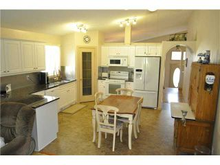 Photo 9: 23 WOODSIDE Road NW: Airdrie Residential Detached Single Family for sale : MLS®# C3626780