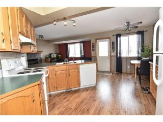 Photo 8: 22 Cimarron Meadows Way: Okotoks House for sale : MLS®# C4104563