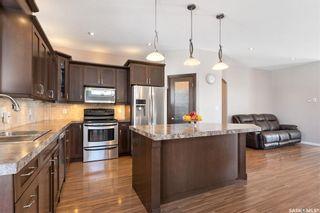 Photo 5: 4419 Sandpiper Crescent East in Regina: The Creeks Residential for sale : MLS®# SK868479