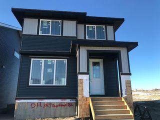 Photo 2: 357 Sundown Road: Cochrane Detached for sale : MLS®# A1052641