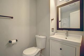 Photo 23: 77 123 Queensland Drive SE in Calgary: Queensland Row/Townhouse for sale : MLS®# A1145434