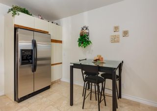 Photo 17: 425 Woodland Crescent SE in Calgary: Willow Park Detached for sale : MLS®# A1149903