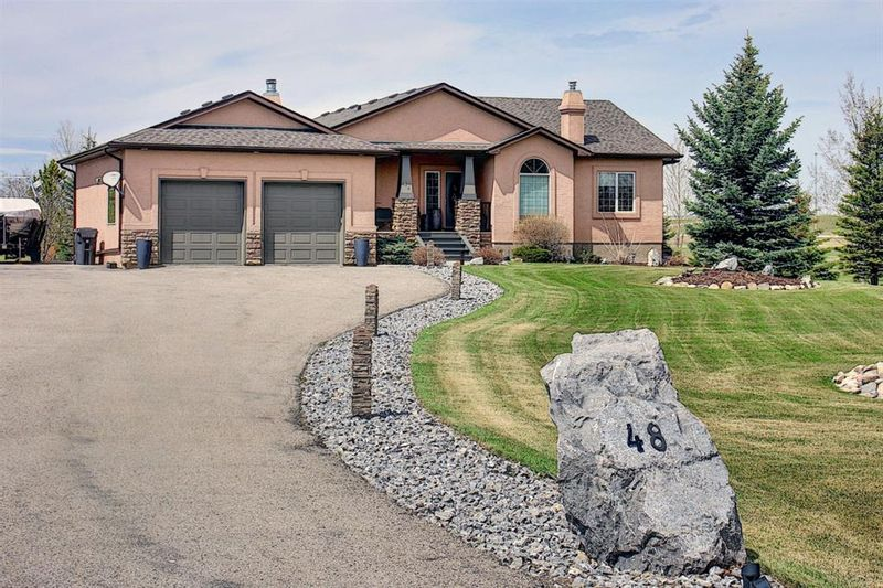 FEATURED LISTING: 48 Silvertip Drive Rural Foothills County