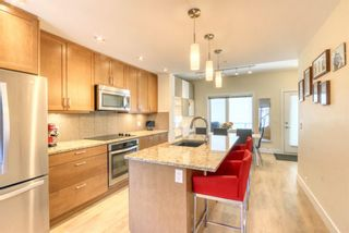 Photo 2: 206 20 Brentwood Common NW in Calgary: Brentwood Row/Townhouse for sale : MLS®# A1129948