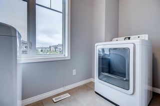 Photo 20: 129 Windstone Park SW: Airdrie Row/Townhouse for sale : MLS®# A1137155