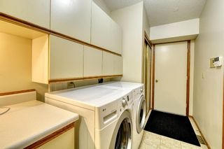 Photo 32: 20A Woodmeadow Close SW in Calgary: Woodlands Row/Townhouse for sale : MLS®# A1127050