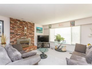 Photo 3: 9358 PRINCE CHARLES Boulevard in Surrey: Queen Mary Park Surrey House for sale : MLS®# R2417764