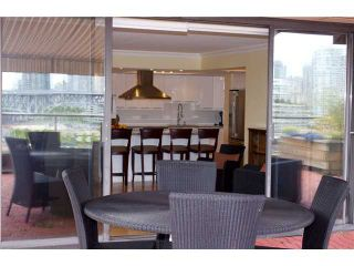 """Photo 9: 910 1450 PENNYFARTHING Drive in Vancouver: False Creek Condo for sale in """"HARBOUR COVE"""" (Vancouver West)  : MLS®# V831435"""