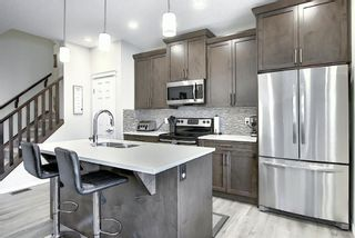 Photo 3: 560 Midtown Street SW: Airdrie Semi Detached for sale : MLS®# A1146689