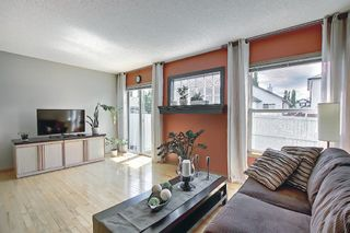 Photo 8: 104 Millview Green SW in Calgary: Millrise Row/Townhouse for sale : MLS®# A1120557