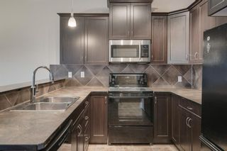 Photo 4: 48 Arbours Circle NW: Langdon Row/Townhouse for sale : MLS®# A1045296