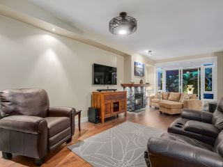 """Photo 2: 108 3600 WINDCREST Drive in North Vancouver: Roche Point Townhouse for sale in """"WINDSONG AT RAVEN WOODS"""" : MLS®# R2067772"""
