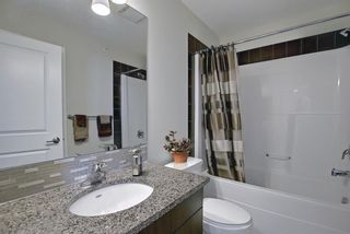 Photo 32: 2407 15 SUNSET Square: Cochrane Apartment for sale : MLS®# A1072593