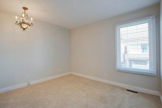 Photo 19: 212 Coachway Lane SW in Calgary: Coach Hill Row/Townhouse for sale : MLS®# A1153091