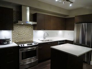 "Photo 2: 107 5811 177B Street in Surrey: Cloverdale BC Condo for sale in ""Latis"" (Cloverdale)  : MLS®# R2121622"