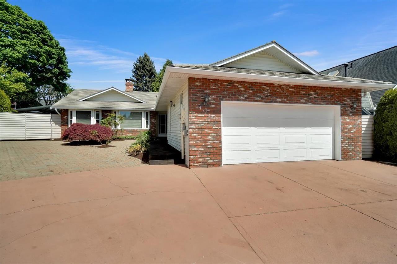 Main Photo: 15049 19A Avenue in Surrey: Sunnyside Park Surrey House for sale (South Surrey White Rock)  : MLS®# R2580183