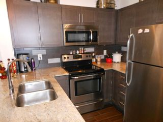 """Photo 7: 214 13468 KING GEORGE Boulevard in Surrey: Whalley Condo for sale in """"Brookland"""" (North Surrey)  : MLS®# R2111340"""