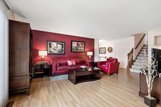 Photo 4: 7 Woodmont Rise SW in Calgary: Woodbine Detached for sale : MLS®# A1092046