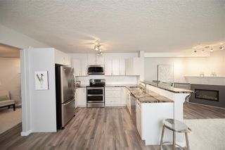 Photo 3: 117 6868 Sierra Morena Boulevard SW in Calgary: Signal Hill Apartment for sale : MLS®# A1122114