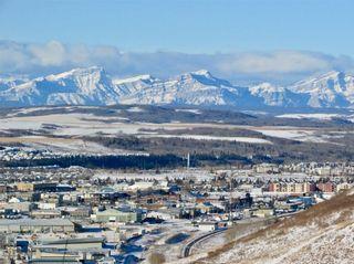 Photo 40: 206 GLENEAGLES View: Cochrane House for sale : MLS®# C4181281