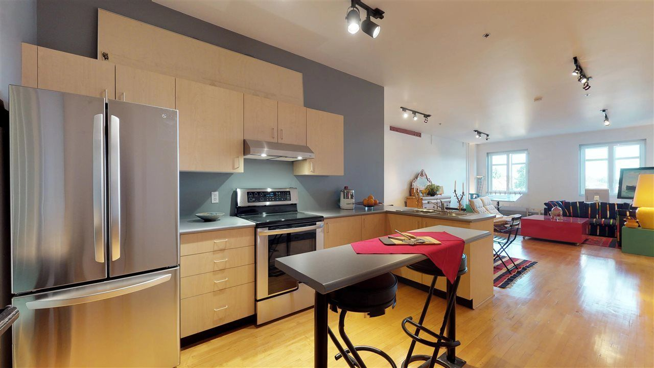 """Photo 2: Photos: 221 2556 E HASTINGS Street in Vancouver: Renfrew VE Condo for sale in """"L'Atelier"""" (Vancouver East)  : MLS®# R2275528"""