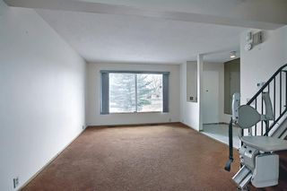 Photo 10: 329 Woodvale Crescent SW in Calgary: Woodlands Semi Detached for sale : MLS®# A1093334
