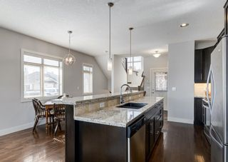 Photo 7: 106 1312 Russell Road NE in Calgary: Renfrew Row/Townhouse for sale : MLS®# A1080835