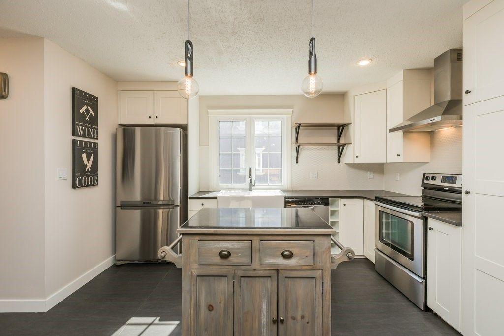 Main Photo: 17042 67 Avenue in Edmonton: Zone 20 Townhouse for sale : MLS®# E4234139