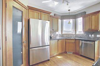 Photo 12: 60 Gleneagles Close: Cochrane Detached for sale : MLS®# A1108593