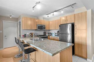 """Photo 1: 805 651 NOOTKA Way in Port Moody: Port Moody Centre Condo for sale in """"KLAHANIE"""" : MLS®# R2578922"""