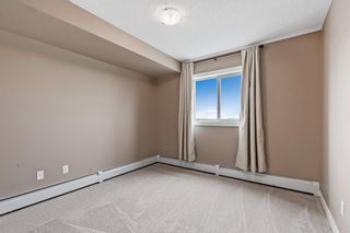 Photo 16: 7411 403 Mackenzie Way SW: Airdrie Apartment for sale : MLS®# A1152134