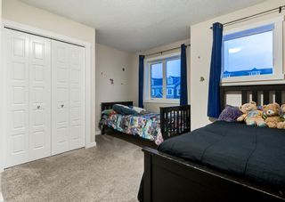 Photo 24: 102 2400 RAVENSWOOD View SE: Airdrie Row/Townhouse for sale : MLS®# A1092501