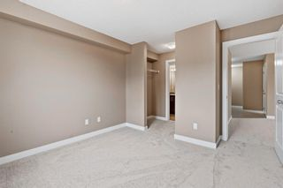 Photo 12: 7411 403 Mackenzie Way SW: Airdrie Apartment for sale : MLS®# A1152134
