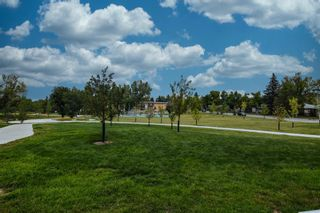 Photo 8: 207 20 Brentwood Common NW in Calgary: Brentwood Row/Townhouse for sale : MLS®# A1143237