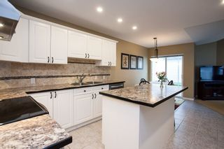 """Photo 7: 49 8555 209 Street in Langley: Walnut Grove Townhouse for sale in """"Autumnwood"""" : MLS®# R2154627"""