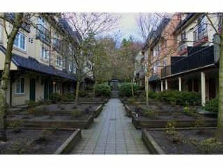 """Photo 1: 84 1561 BOOTH Avenue in Coquitlam: Maillardville Townhouse for sale in """"THE COURCELLES"""" : MLS®# V1087510"""