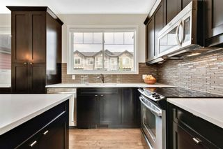 Photo 1: 8 NOLAN HILL Heights NW in Calgary: Nolan Hill Row/Townhouse for sale : MLS®# A1015765