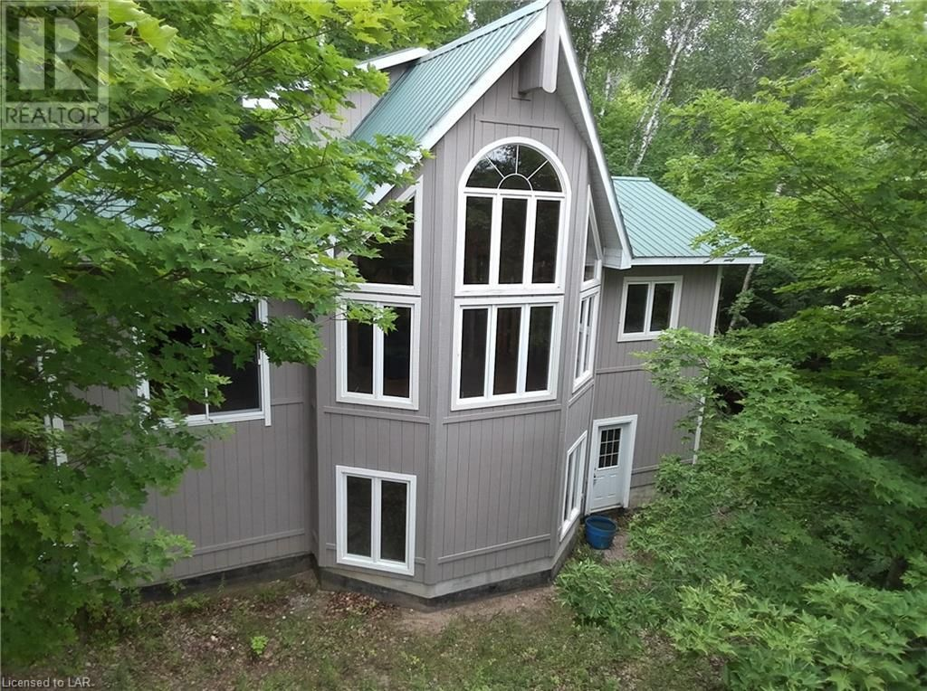 Attractive, well built cottage started on this private lot.