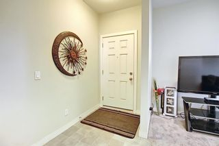 Photo 3: 2103 Jumping Pound Common: Cochrane Row/Townhouse for sale : MLS®# A1119563