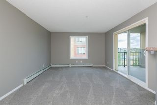 Photo 9: 8329 304 MACKENZIE Way SW: Airdrie Apartment for sale : MLS®# A1128736
