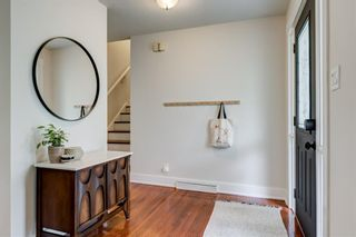 Photo 3: 64 Rosevale Drive NW in Calgary: Rosemont Detached for sale : MLS®# A1141309