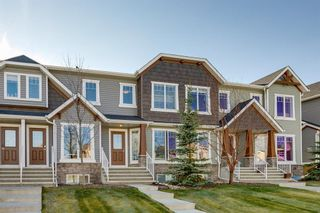 Photo 2: 113 ASPEN HILLS Drive SW in Calgary: Aspen Woods Row/Townhouse for sale : MLS®# A1057562