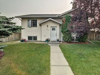 Photo 1: 36 West Boothby Crescent: Cochrane Detached for sale : MLS®# A1135637
